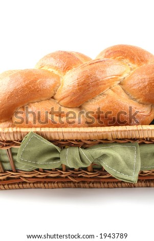 basket of challah bread isolated on white - stock photo