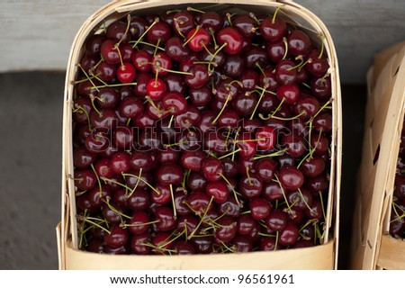 Basket of cherries on display at a Farmer's Market