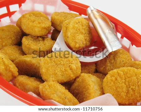 Basket of Chicken Nuggets With Sweet and Sour Sauce - stock photo