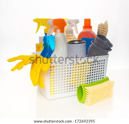 Basket of Cleaning Supplies and Tools - stock photo