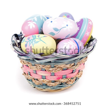 Basket of colorful Easter eggs on a white background - stock photo