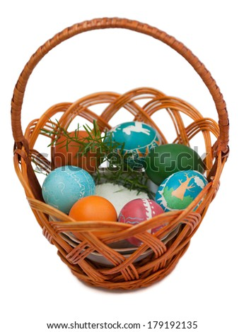 Basket of colorful Ukrainian Easter eggs (hand-painted). Isolated on a white background