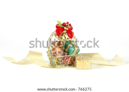 Basket of decorative gifts on white background