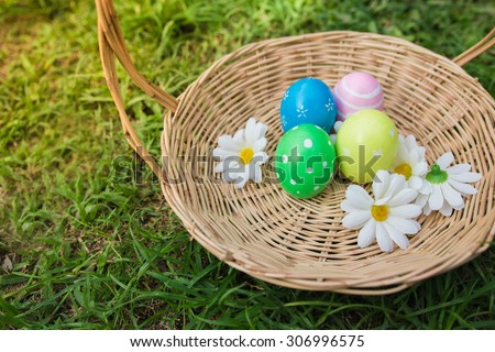 Basket of easter eggs  - stock photo