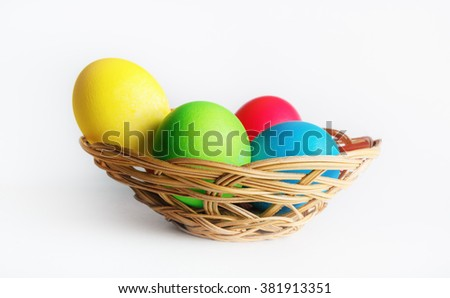 Basket of Easter eggs. Bright colorful easter eggs.Selective focus. - stock photo