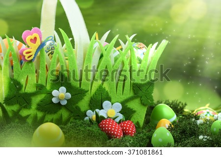 Basket of easter eggs on meadow  - stock photo