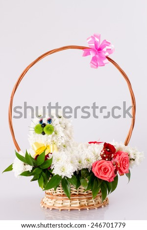 basket of flowers. flowers made in the form of a cat - stock photo