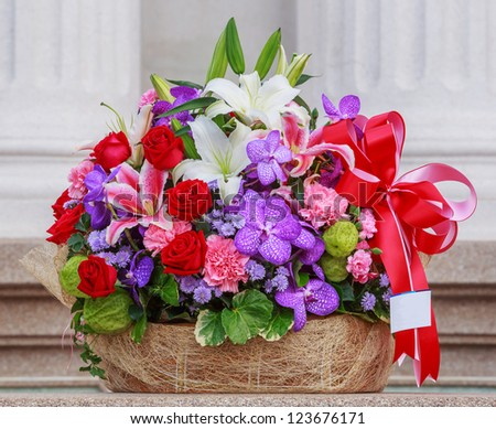 Basket of flowers with namecard tag - stock photo