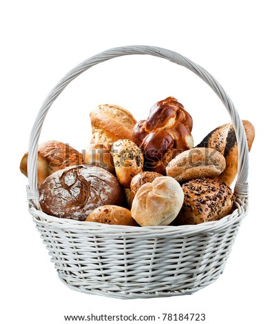 Basket of fresh baked bread at the country market. - stock photo