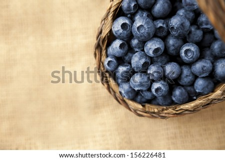 basket of fresh blueberries on jute  - stock photo