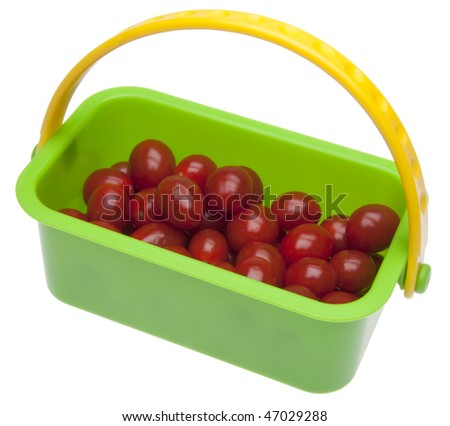 Basket of Fresh Cherry Tomatoes isolated on white with a clipping path.