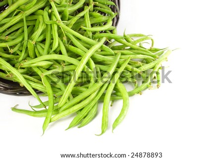 Basket of fresh green beans spilled out with white background and copy space