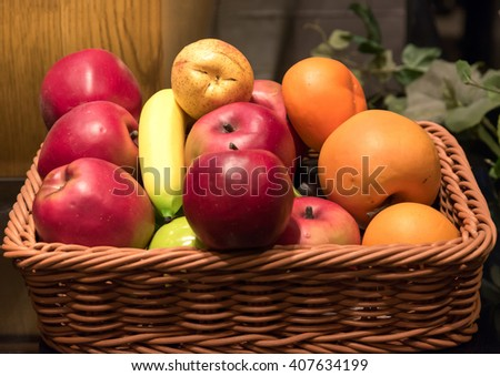 Basket of fresh organic fruits. - stock photo