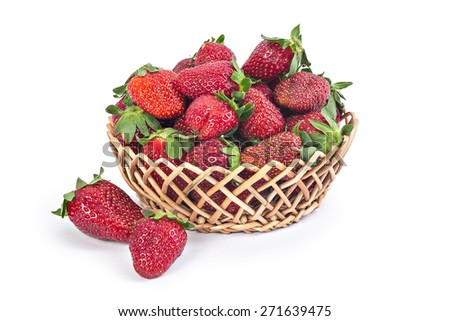 Basket of fresh red ripe organic strawberries isolated on white background  - stock photo
