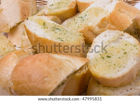 Basket of Garlic bread close up background / texture image. - stock photo