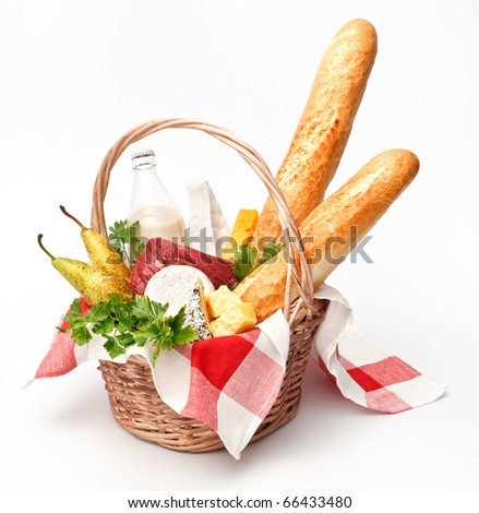 Basket of goods with cheese, bread and meat on white background - stock photo