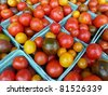 Basket of heirloom cherry tomatoes - stock photo
