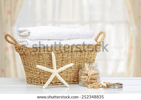 Basket of laundry with pegs - stock photo