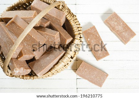basket of marble pattern homemade soaps drying, bright wooden background - stock photo
