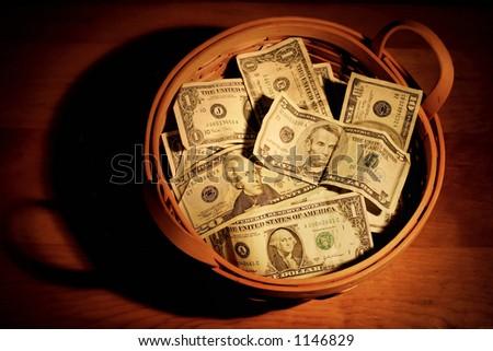 Basket of money - stock photo
