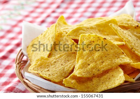 Basket of nachos and dip - stock photo