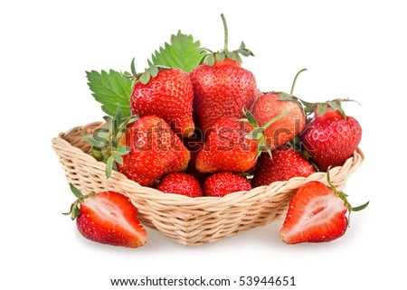 Basket of red strawberry fruits with green leaves isolated on white background