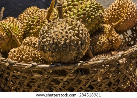 Basket of spiky and smelly Durian for sale in a local market
