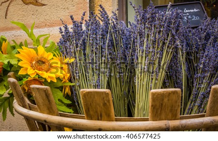 Basket of sunflowers and lavender in France - stock photo