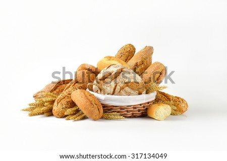 basket of various breads on white background - stock photo