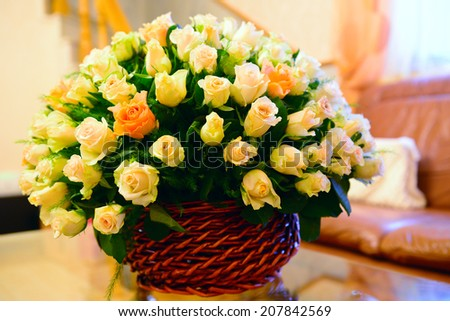 Basket of vibrant roses - stock photo