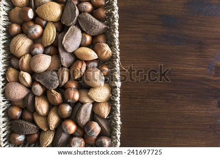 Basket of whole nuts in shell with copy space, can be used vertically or horizontally. - stock photo