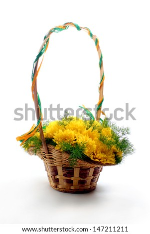 Basket of yellow flowers on white - stock photo