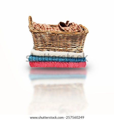 basket on a towel on a white background - stock photo