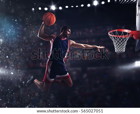 Basket player throws the ball at the stadium