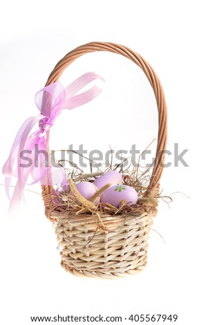 basket wicker with decoration easter eggs on hay  - stock photo