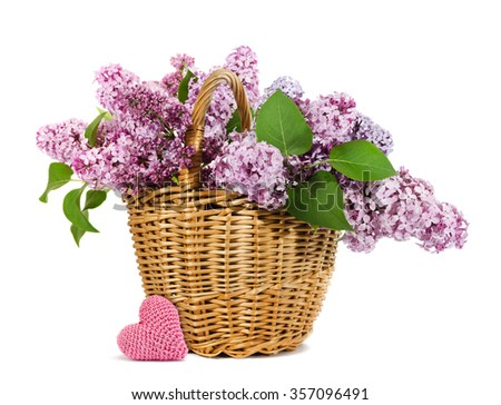basket with a branch of lilac flower with a knitting heart isolated on a white - stock photo