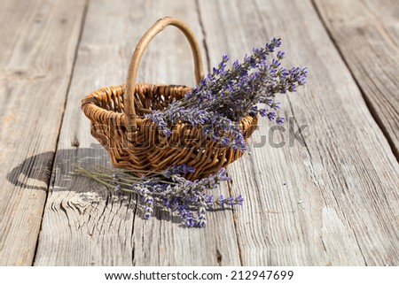 Basket with a lavender, on wooden background - stock photo