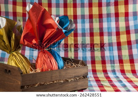 basket with Brazilian Easters eggs, on a colored background - stock photo