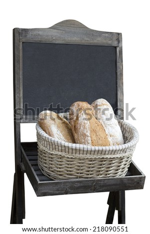 Basket with bread and board for prices, isolated - stock photo