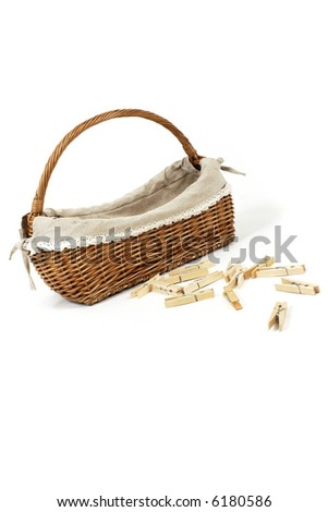 Basket with clothes pins - stock photo