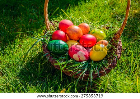 Basket with colored eggs - stock photo