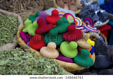 Basket with colorful sponges for exfoliate in a traditional  spices market in Marrakesh, Morocco. Colorful sponges for exfoliate. - stock photo