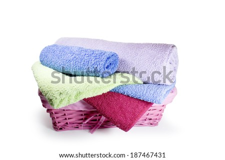 Basket with colorful towel - stock photo