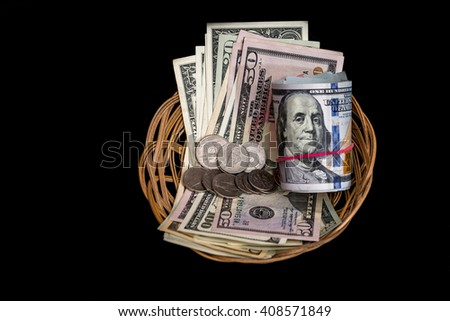 Basket with dollar isolated on black - stock photo