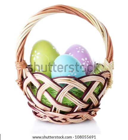 basket with Easter eggs isolated on white - stock photo