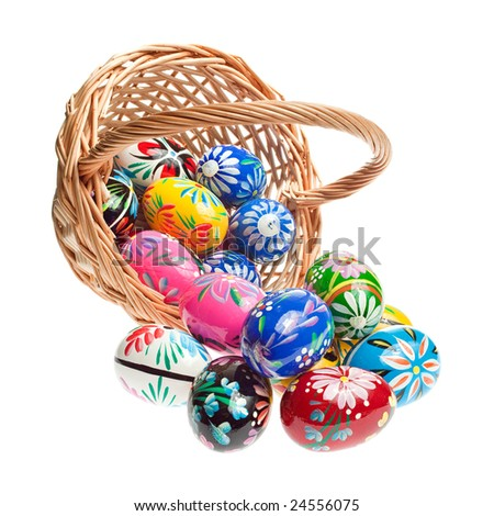 Basket with Easter Eggs on white background - stock photo