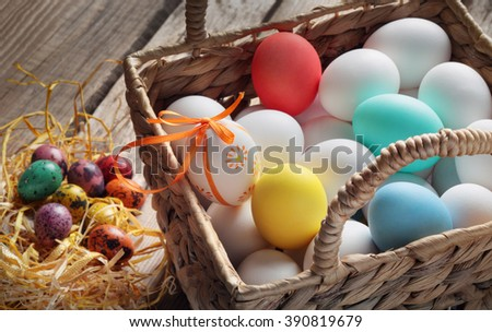 basket with eggs for Easter on an old table - stock photo