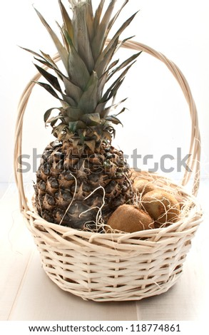 Basket with fruits - pineapple and kiwis