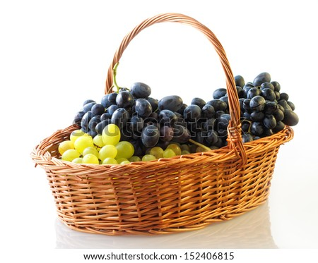 Basket with grapes, isolated - stock photo