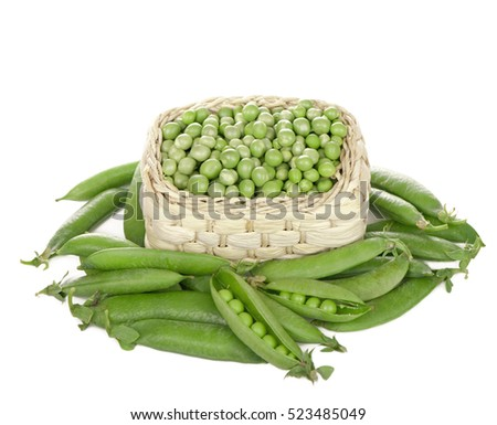Basket with green peas the isolated.